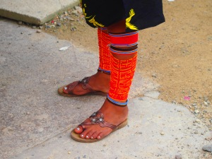 Women wear bracelets around their arms and ankles called chaquiras