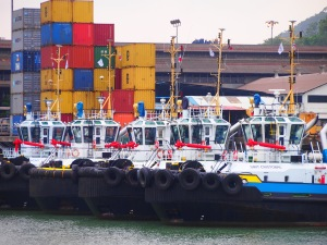 Parked tug boats awaiting ships to be steered.