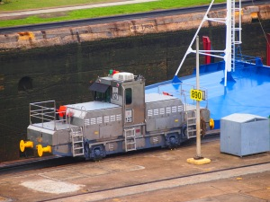 "The ""mules"" directing the ship inside the lock"